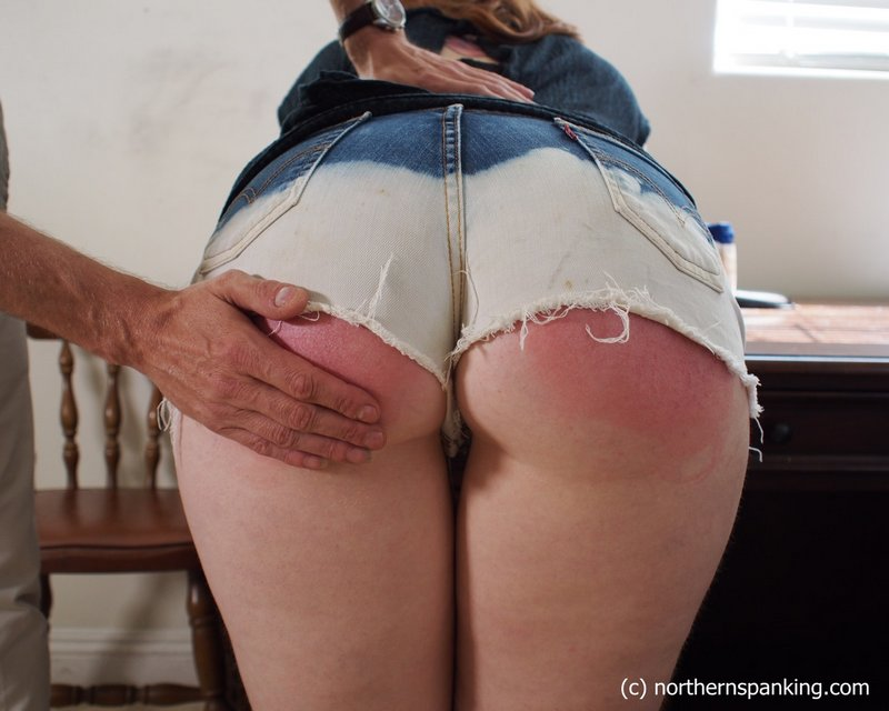 spank-wearing her denim shorts