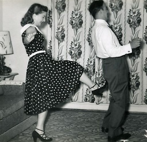 feisty 1950s wife kicks her husband in the butt