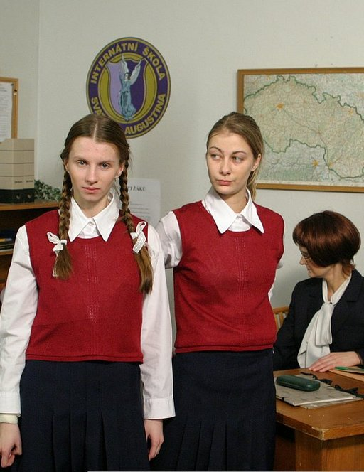 two school girls in the office waiting for their caning punishment