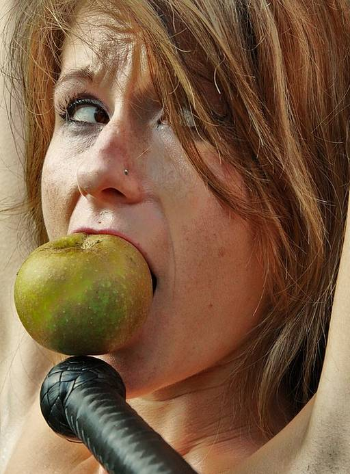 gagged with an apple in her mouth during a pussy whipping