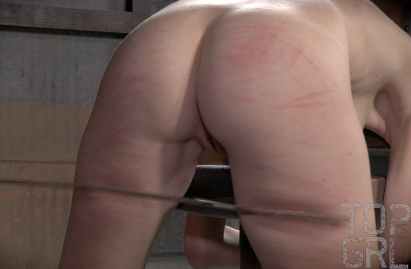 caning her thighs