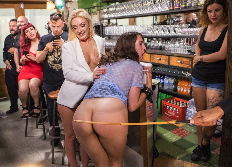 public caning begins in a spanish bar