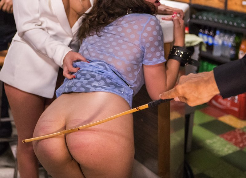 cane strikes bottom in public caning in Barcelona