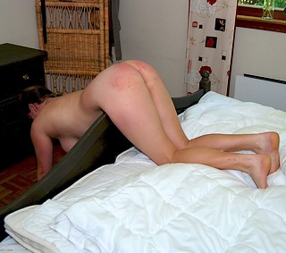 spanked while bent over the foot of the bed