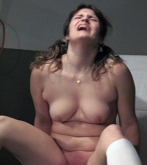 her anguished face as he spanks her pussy harder with his leather belt