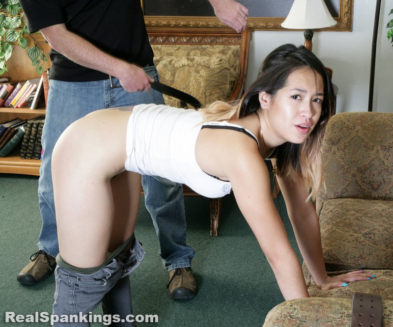 spanking peaches with a belt