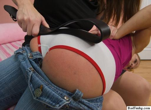 tushy spanked with a leather belt over panties
