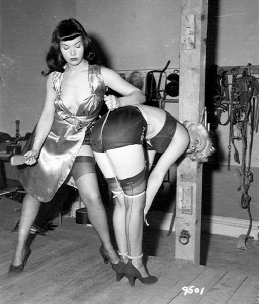 Bettie Page spanking a bondage girl