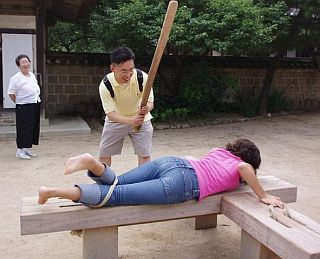 tourist spanking, with an oar
