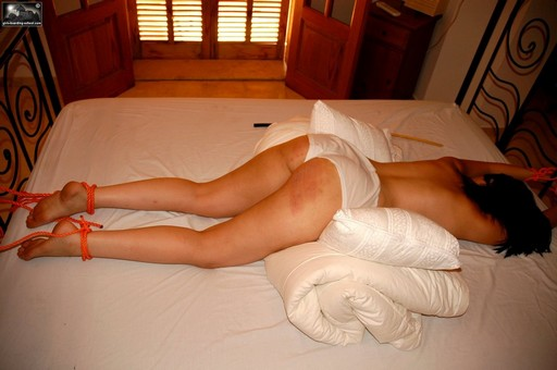 tied to her own bed for a punishment caning
