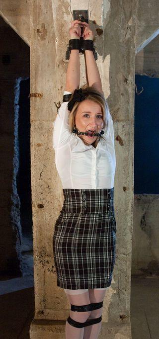 bondage schoolgirl caned on her bare pussy