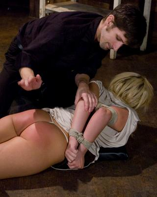 blonde girl in bondage is well spanked