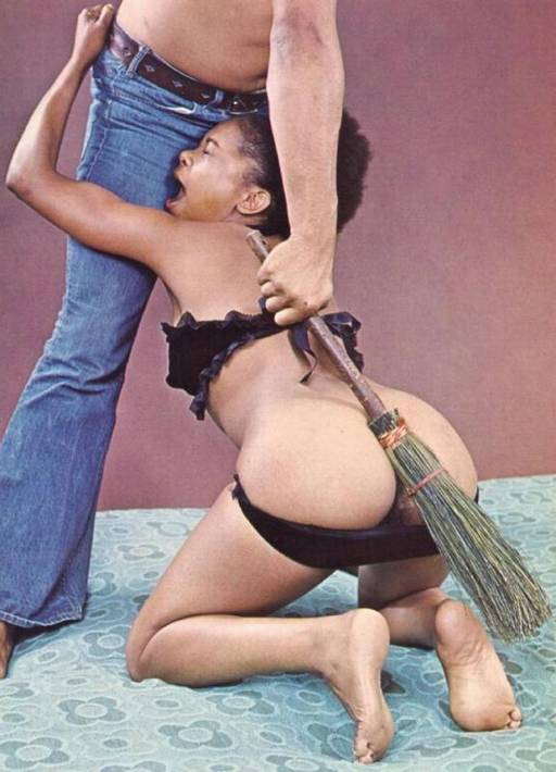 spanking her black bottom hard with a rustic twig broom