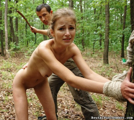 amy tied to a tree for a brutal punishment spanking with a leather strap