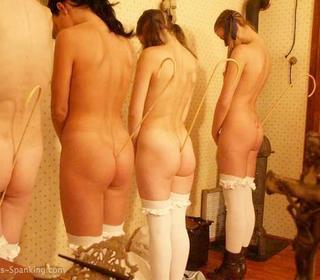 girls holding canes between their butt cheeks