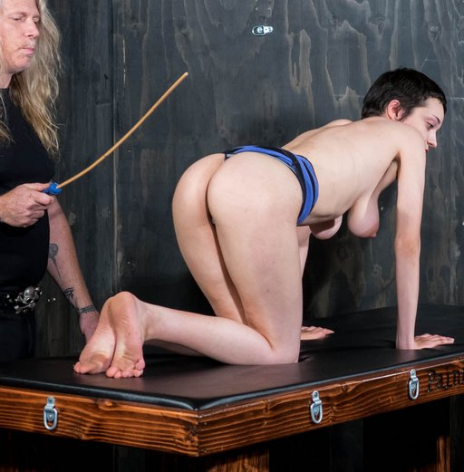 caning a happy pain slut