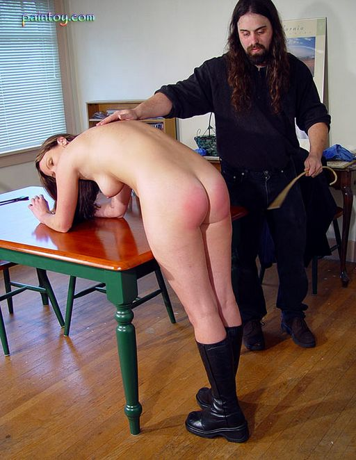 caned while wearing nothing but her leather boots