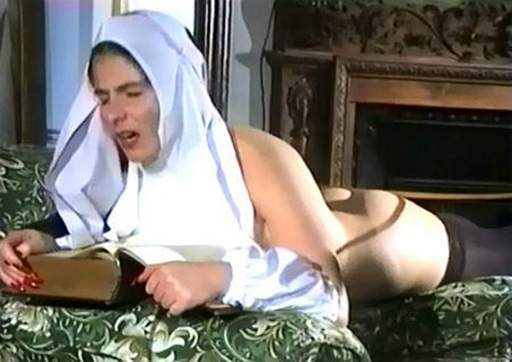 nun clutching her bible as she is caned