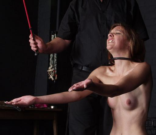 caning the palms of the slavegirl