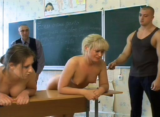 bent over the teacher\'s desk for caning