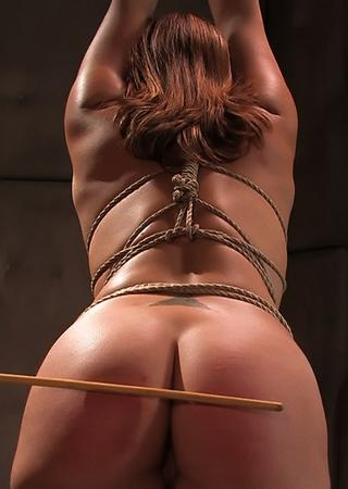caned while dealing with a butt plug