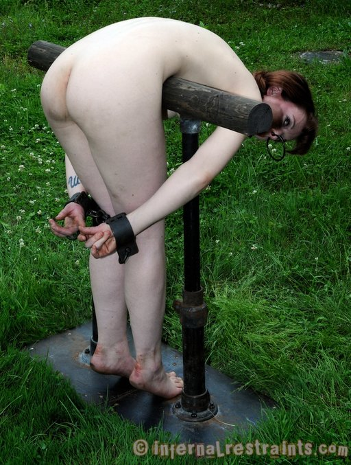 Hazel looking up hopefully after being tied to the punishment bar