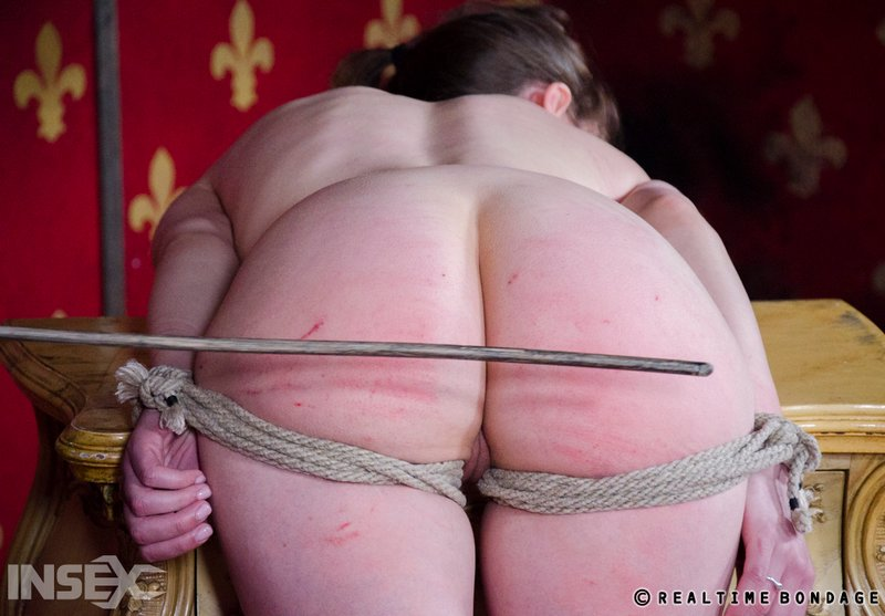 light bondage and a hard caning