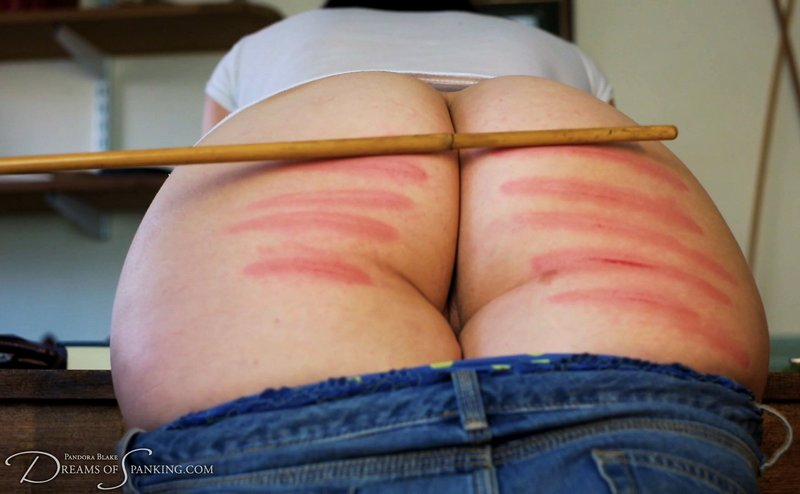 a caning mistake leads to pretty stripes for Pandora Blake at Dreams Of Spanking