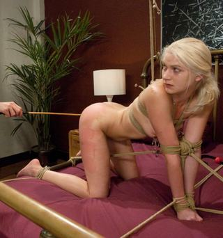 Natasha Lyn crying after being tied up and caned well