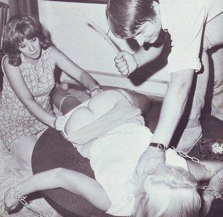 hard bondage spanking with a wooden coat hanger