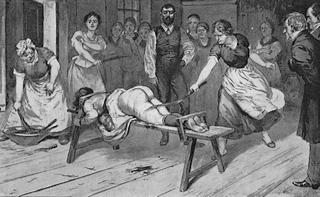 woman on a whipping bench being punished in public by several other enthusiastic women