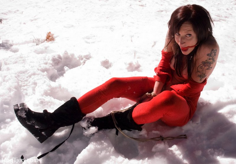 sizzling hot bottom stuck in the snow to cool off after a caning