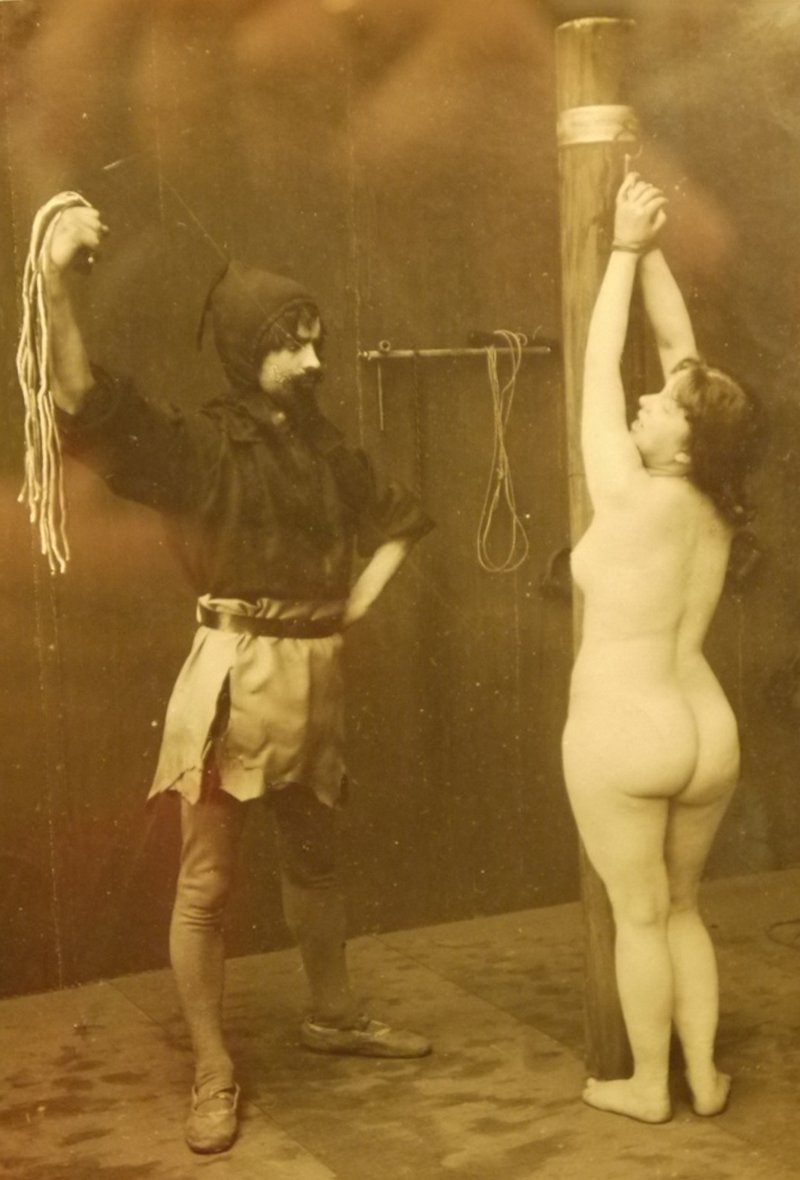 bondage flogging with a rope whip