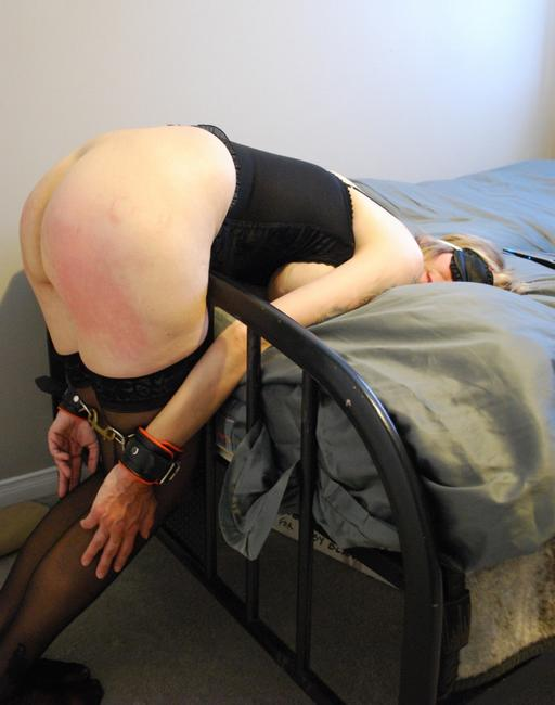 cuffed to the bed for her bondage spanking