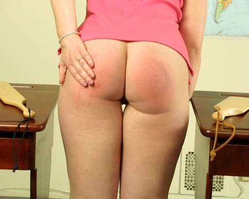 two wooden paddles left her bottom sore