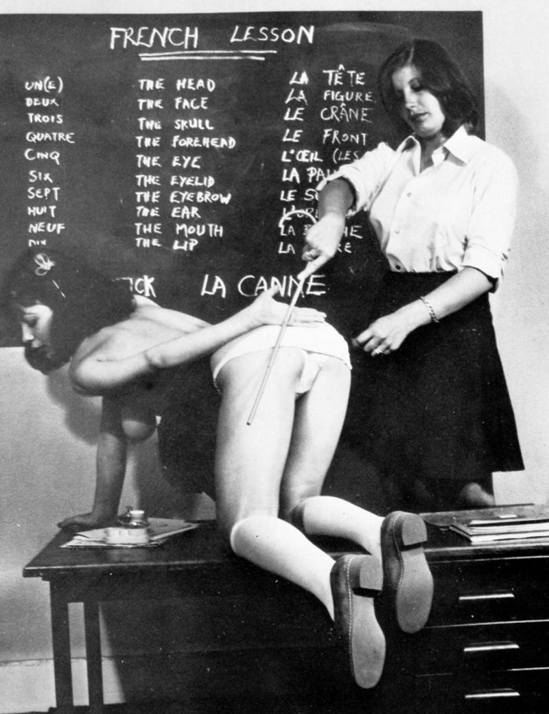caned by the french teacher on the desk in front of the chalkboard blackboard until she learns