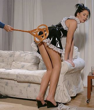 pretty french maid gets a carpet beater spanking