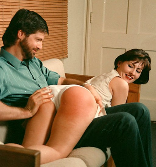 smiling as they enjoy a spanking