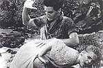Production still showing Elvis spanking Jenni Lee in Blue Hawaii