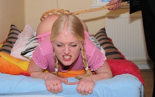 pig-tailed blonde getting spanked hard with a carpet beater