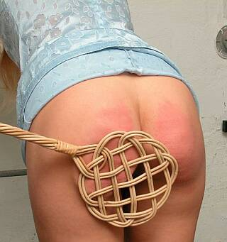 carpet beater spanking a nice red bottom