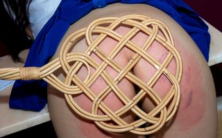 carpet beater spanking