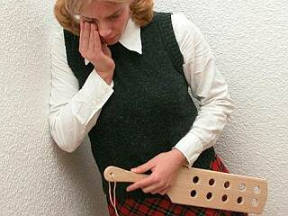 crying schoolgirl after her paddle spanking