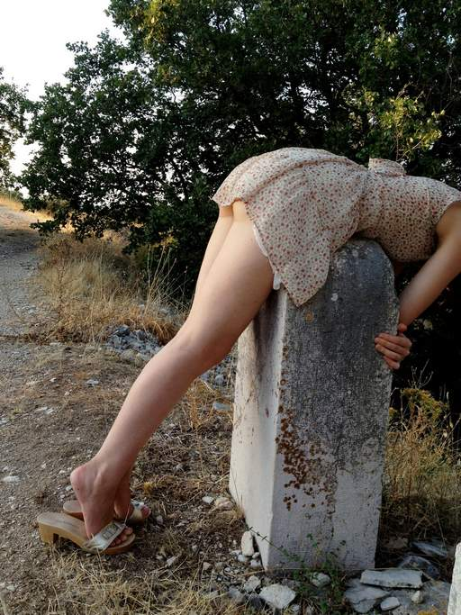 bent over an ancient headstone to be chastised for not wearing panties