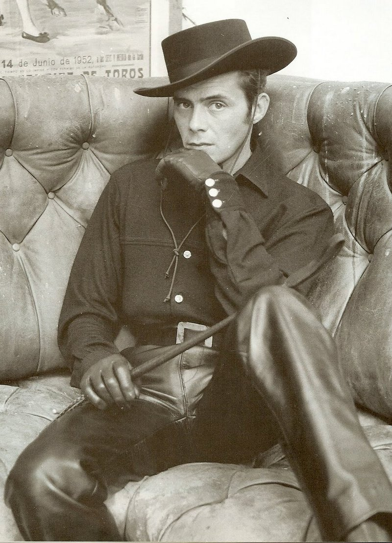 dirk bogarde in full leather cowboy kit is going to fetish the fuck out of somebody