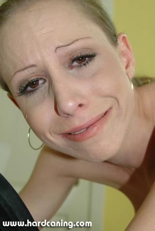 hard caned girl in tears