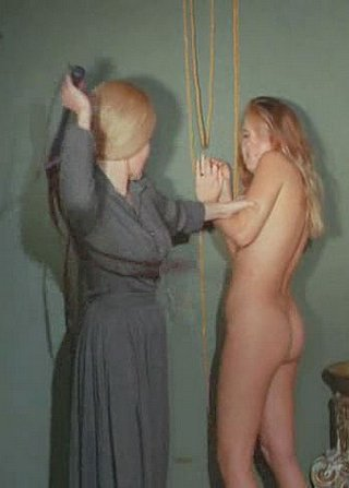 vicious headmistress whips naked girl in her care