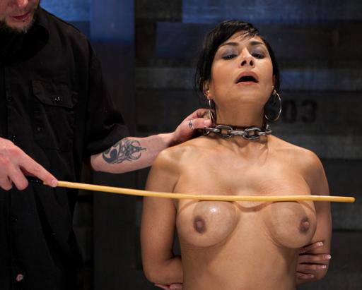 caned on her boobs with a big heavy cane