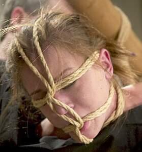 dominatrix Audrey Leigh in face bondage