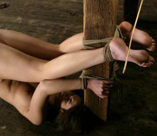 feet tied for bastinado caning
